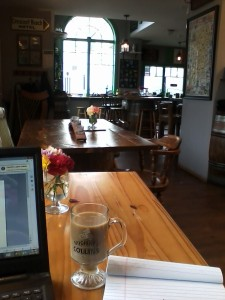 Sitting at a local Irish pub and writing.