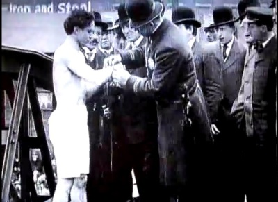 Screenshot of film showing Harry Houdini's jump, handcuffed, from the Weighlock Bridge in Rochester. It was his first manacled stunt. (Click image to be taken to the video.)