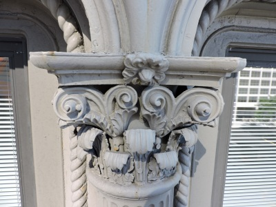 These architectural details are made from cast iron. Scott repairs and replaces them with more lightweight and durable fiber glass.