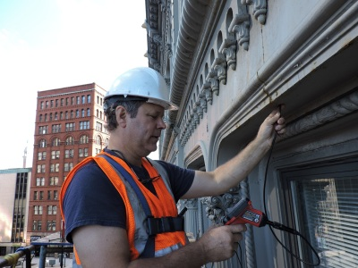Scott checking the integrity of the facade.