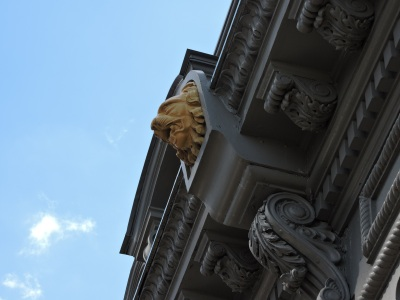 The lion heads, just under the first row of dormer windows.